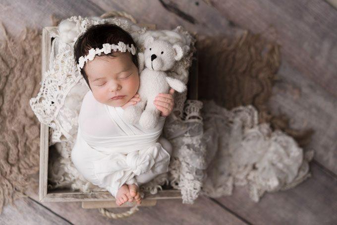 Newborn Baby Photo Cuddling a Teddy Bear in Athens GA